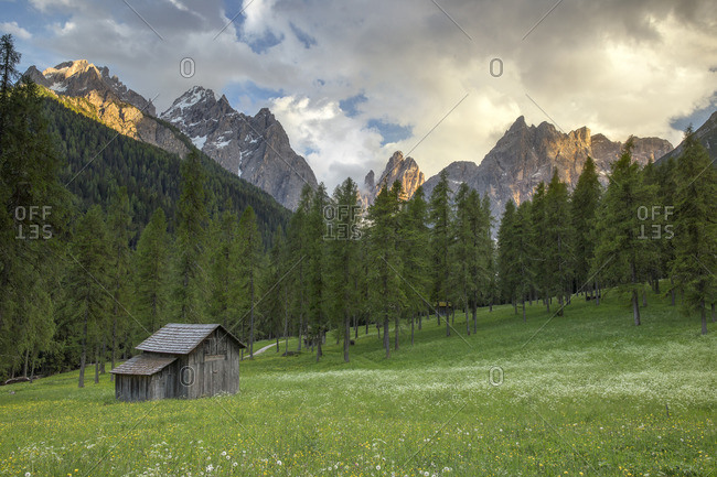 Meadows of Fiscalina valley with the Sesto peaks at sunset in the background, Bolzano district