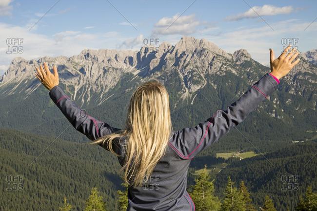 Hiker looks at the landscape from Val Visdende, Comelico, Val Val Visdende, Santo Stefano di Cadore, Veneto, Europe, Italy