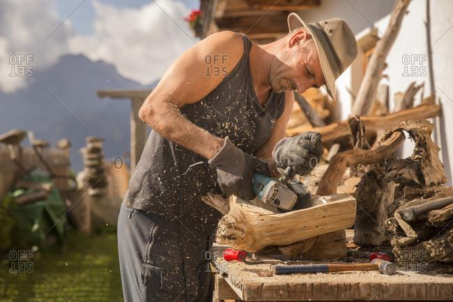 Trentino Alto Adige, Italy - September 24, 2016: Wood worker at the alpine lodging Niggler (Nigglerhof) in San Silvestro valley