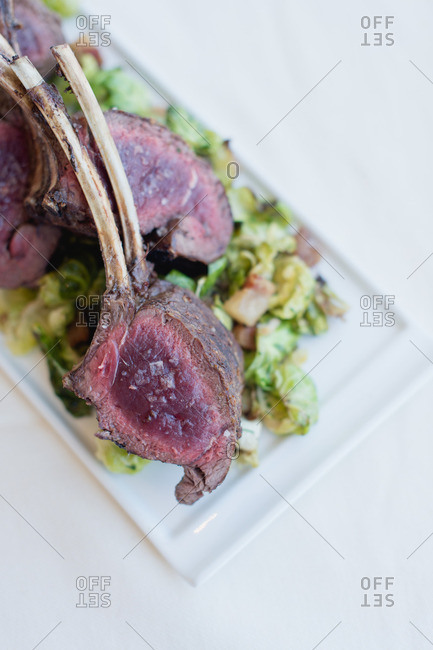 Close up of lamb chops on a white plate