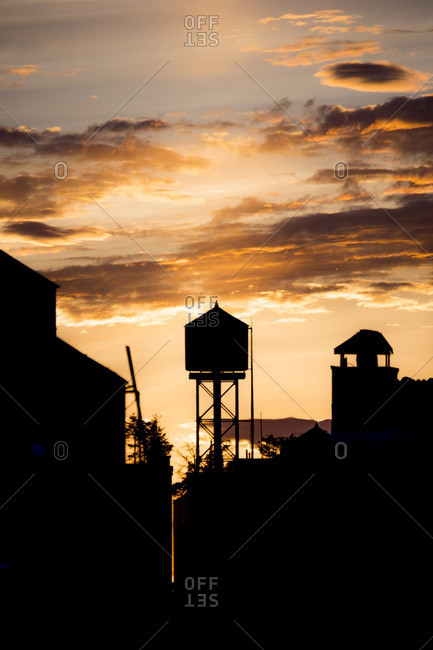 Silhouette of buildings and a water tower in the Upper West Side at sunset