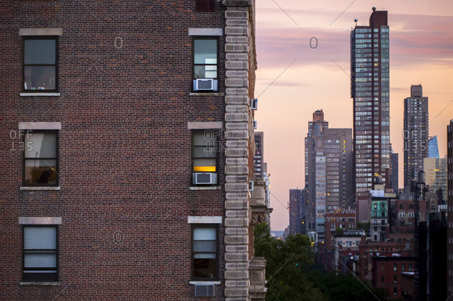 Residential buildings and skyscrapers on the Upper West Side at sunset