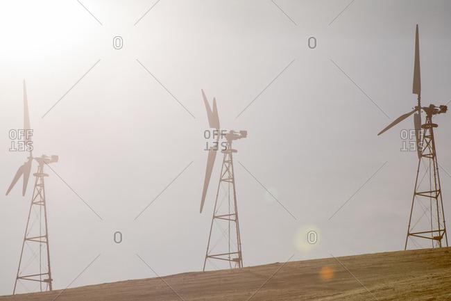 Wind turbines on a hazy hill