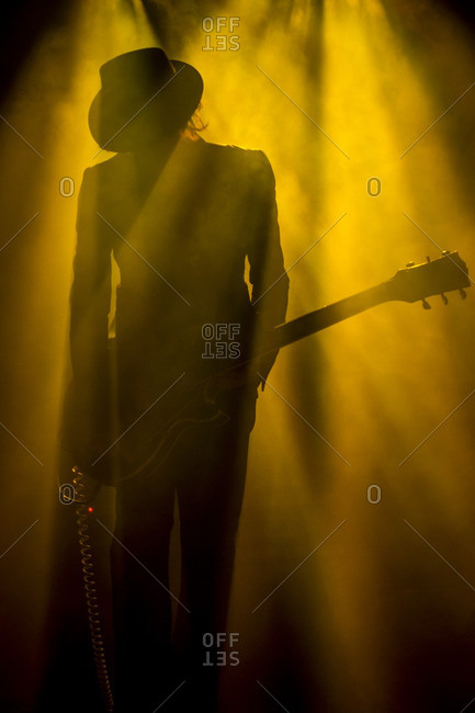 Silhouette of a musician on stage at a concert