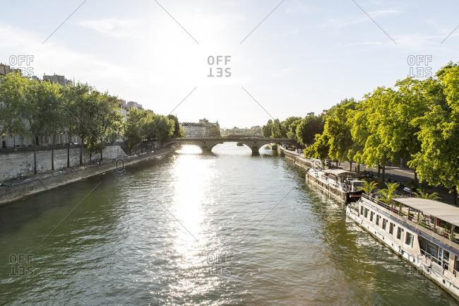 Paris, France - June 29, 2015: Bridge and trees lining the Seine