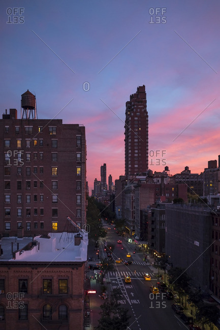 Residential buildings and a street on the Upper West Side at sunset