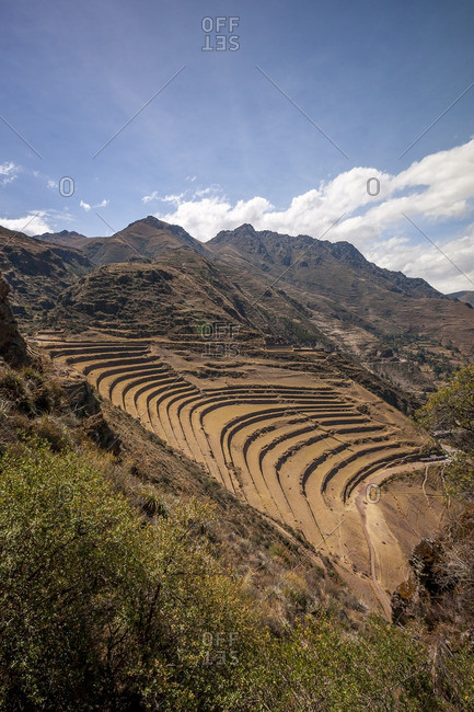Mountainside with terraced farmland in the Sacred Valley, Peru
