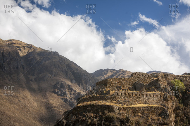 Incan ruins on a mountainside above the Sacred Valley, Peru
