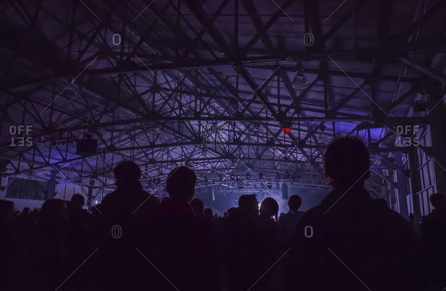 Silhouettes of a crowd at an indoor music festival in San Francisco