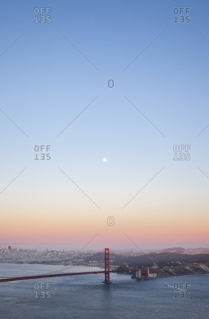 Supermoon in a twilight sky over the Golden Gate Bridge