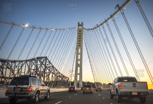San Francisco, United States - March 15, 2014: Cars crossing the Bay Bridge at sunset