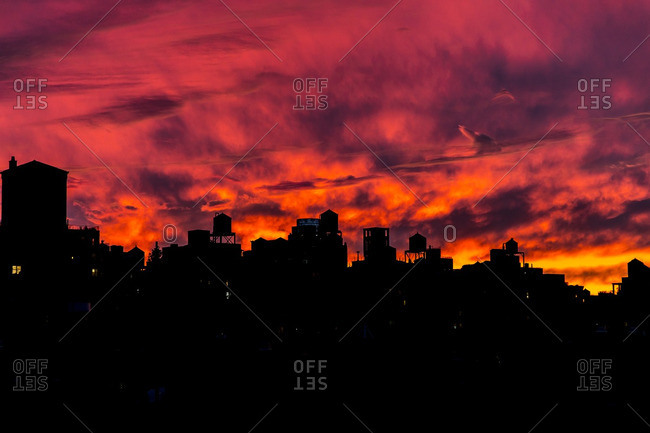 Silhouette of the skyline on the Upper West Side, New York against a bright sunset