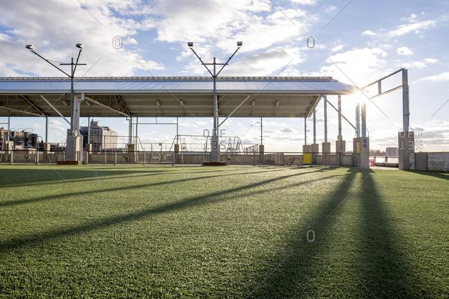 Empty turf grass athletic field at Brooklyn Bridge Park