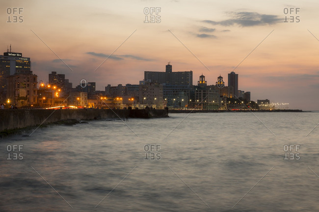 Havana, Cuba - April 30, 2016: The Malecon waterfront at dusk