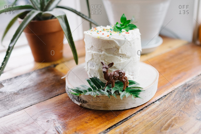 Small birthday cake on a wooden plate