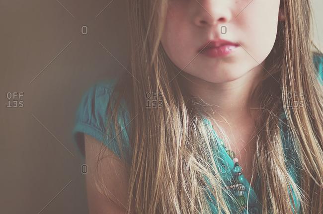 Close-up of a girl wearing a blue shirt
