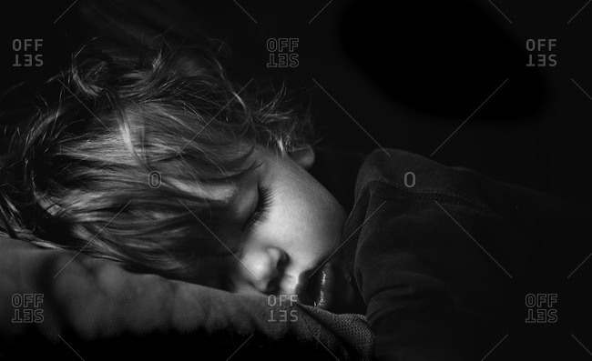 Black and white portrait of a sleeping boy