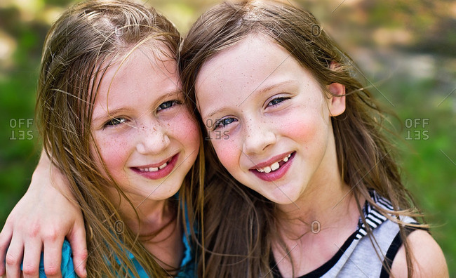 Portrait of two girls smiling together for the camera