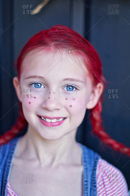 Girl in costume with freckles and red hair