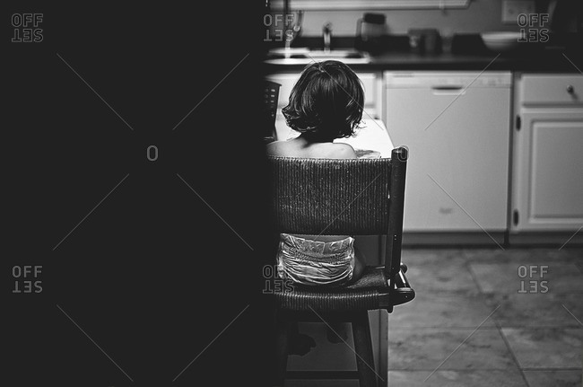 Toddler child sitting in the kitchen