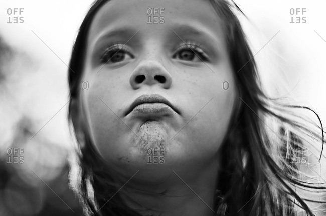 Portrait of a pouting girl with dimpled chin