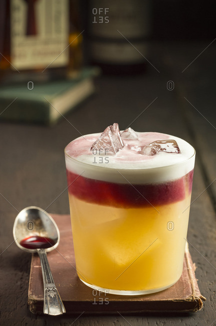 New York sour served in a glass on an old book