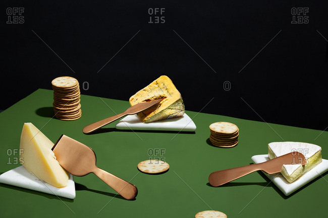 Three types of cheese served with crackers