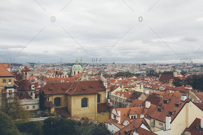 Europe - November 24, 2013: Cityscape with church spires and tile rooftops