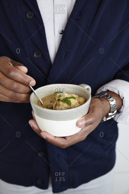 Man's hands holding soup