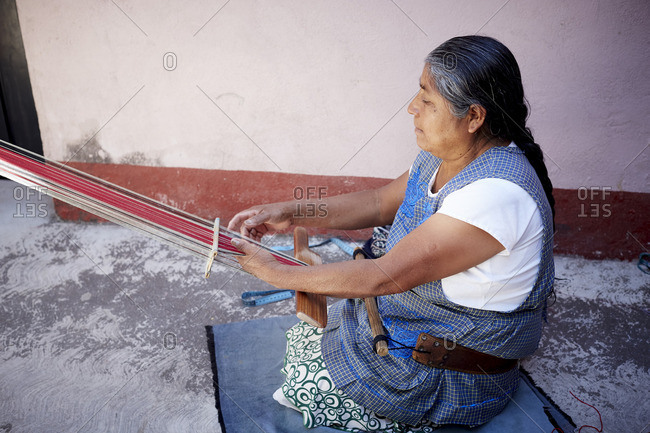 Mexico - October 27, 2016: Mexican woman weaving outside on hand loom