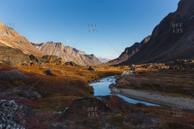 Sunrise over mountains and river in Greenland
