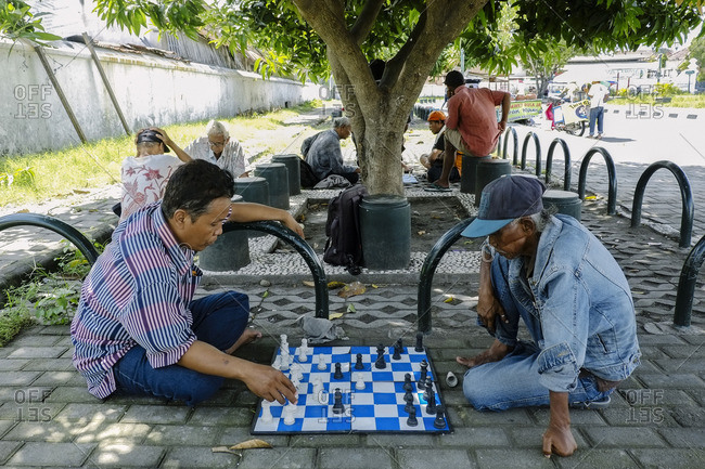 Yogyakarta, Indonesia - January 23, 2016: Locals playing chess at Alun Alun Selatan