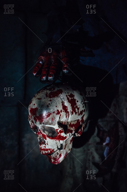 Fake skull with bloody hand as Halloween decoration, in Guangzhou, China