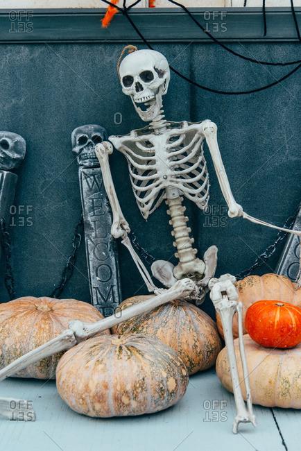 Skeleton decoration sitting on pumpkins, in Guangzhou, China