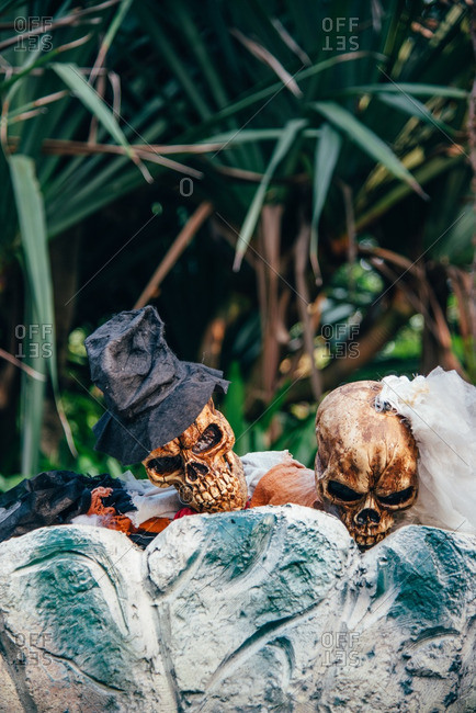 Skeletons decorations as bride and groom peeking over grave stones in Guangzhou, China
