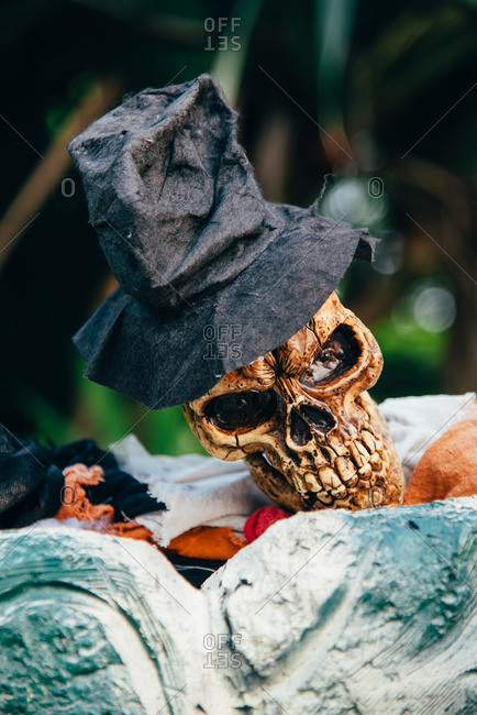 Close-up of skeletons decorations dressed as a groom, peeking over grave stones