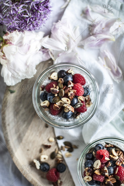 Two glasses with chia pudding and berries