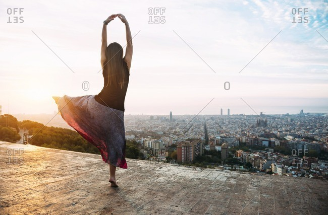Spain- Barcelona- Woman ldancing at view point over city