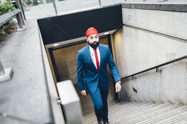 Indian businessman walking up stairs