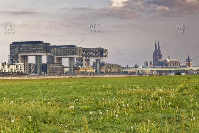Germany- Cologne- view to Crane Houses at Rhine harbour and Cologne Cathedral in the background