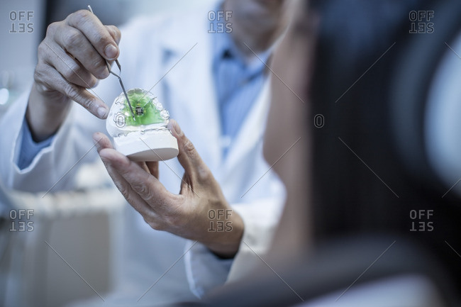 Dentist showing patient dental mold