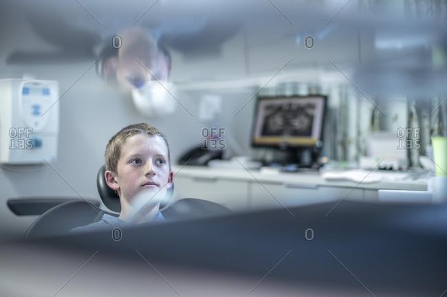 Nervous boy in dental surgery