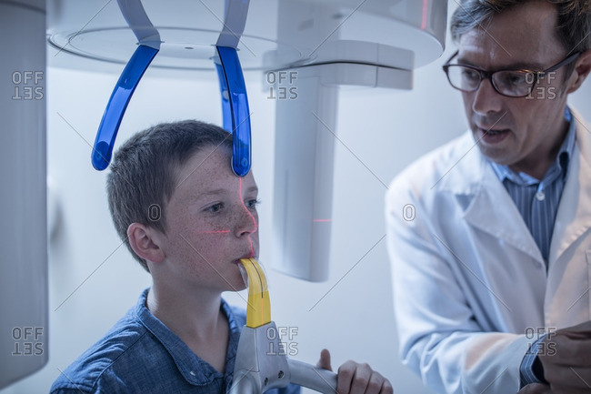 Boy at the dentist in x-ray machine