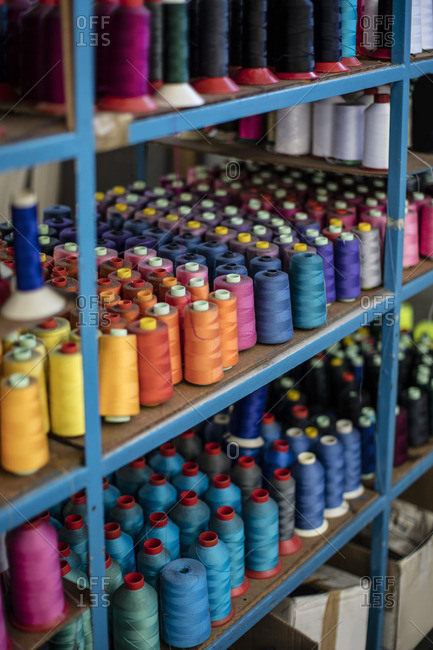 Multicolored cotton reels on shelf
