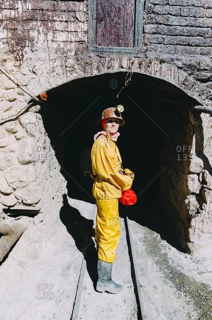 Bolivia- Potosi- tourist wearing protective clothing ready to visit the Cerro Rico silver mine