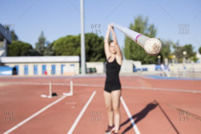 Female pole vaulter holding pole