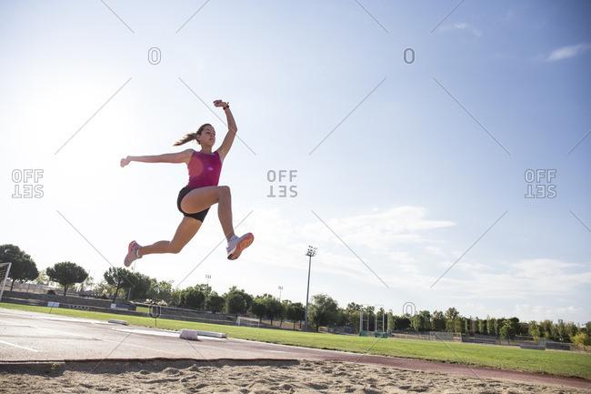 Female long jumper mid-air