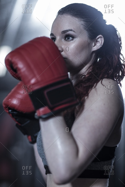 Female boxer practising in gym