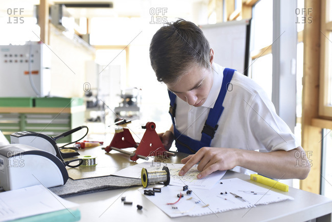 Student assembling circuit board