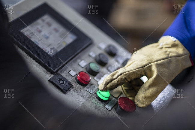 Hand operating control panel in factory